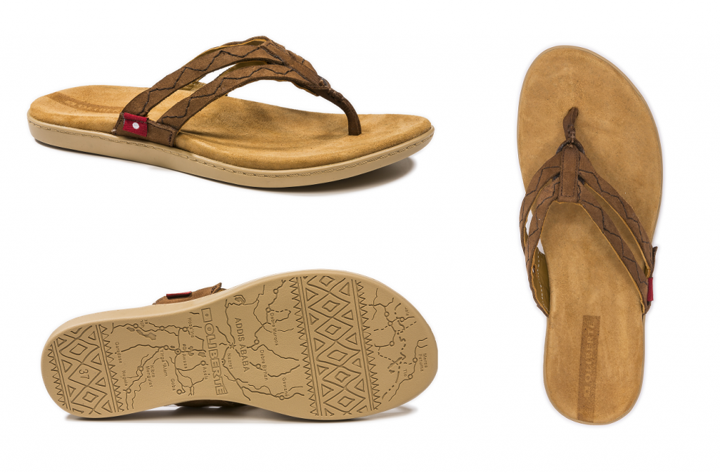 e2633541172a This double strap sandal features a hand-stiched zig zag detail along with a  supple goat suede wrapped footbed.